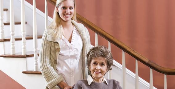 woman and senior woman smiling