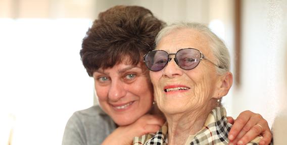 two senior woman smiling