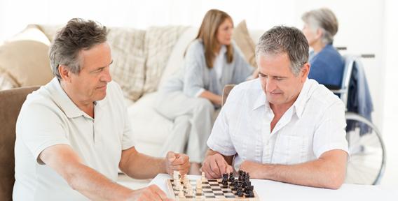 two senior man playing chess
