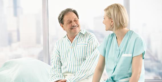 young woman and senior man talking